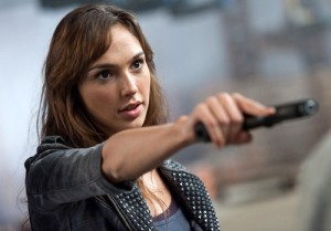 Here she is being badass and pointing a gun